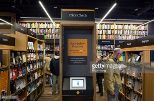 Customers shop at Amazon Books in Seattle, Washington, on Tuesday, Nov. 3, 2015. The online retailer Amazon.com Inc. opened its first brick-and-mortar location in Seattle's upscale University Village mall. Photographer: David Ryder/Bloomberg